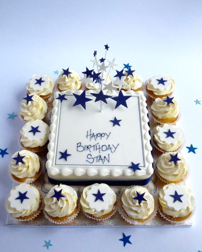 Cake with cupcakes around in navy