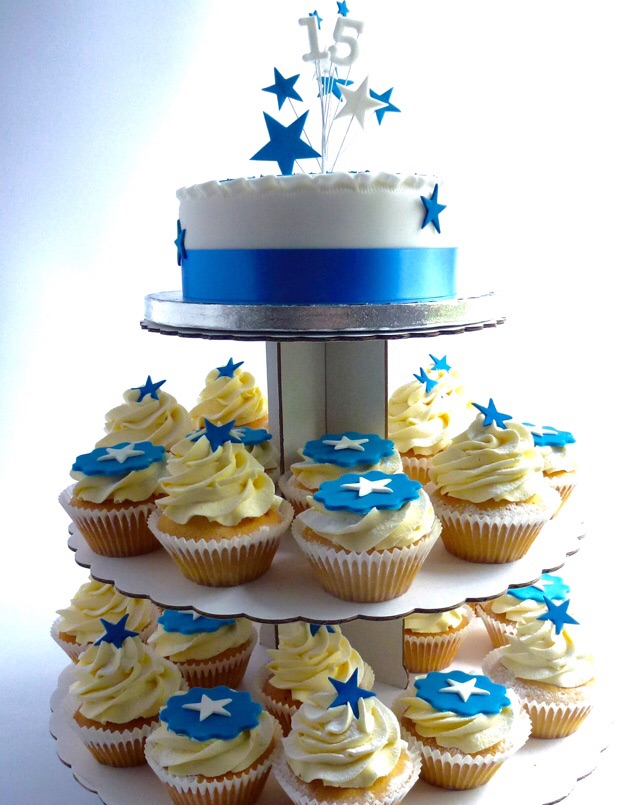 Cake with cupcakes on stand with star topper in blue