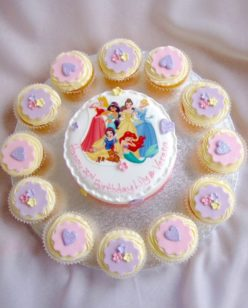 round cake and cupcakes with photo topper