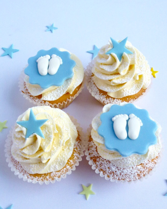 Blue cup cakes with baby feet and star decoration