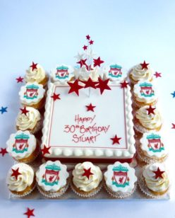 cake with cupcakes around with football team logo
