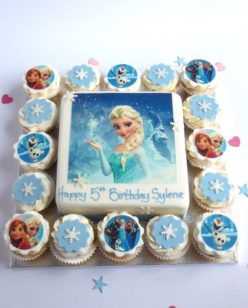Cake with cupcakes and frozen character toppers