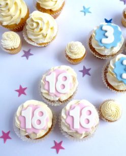 Pink and blue numbered cup cakes