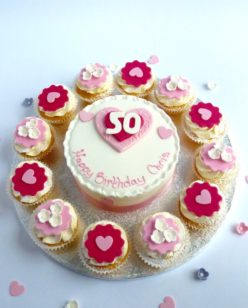cake and cupcakes with heart decoration