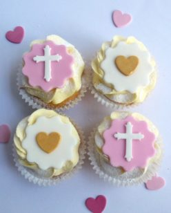 pink cupcakes with cross and heart