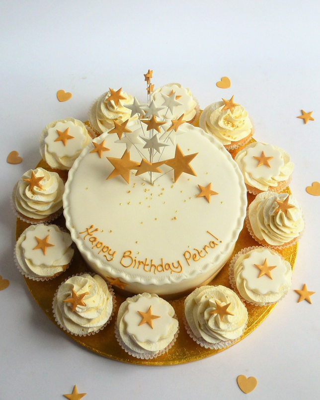 cake and cup cakes with gold star topper
