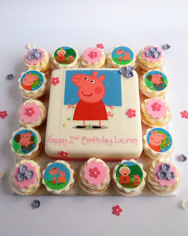 Cake with cupcakes and peppa pig toppers