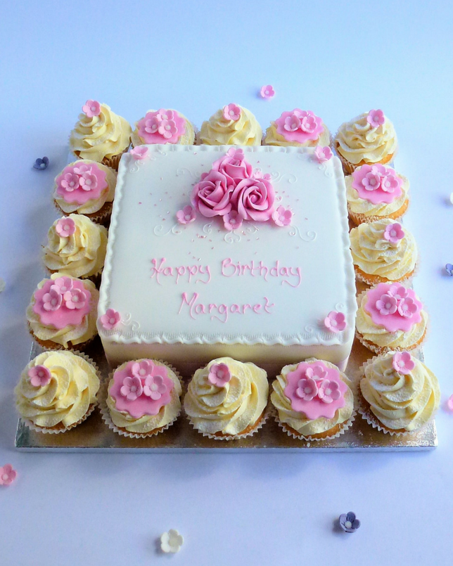 cake with cupcakes and pink flower spray