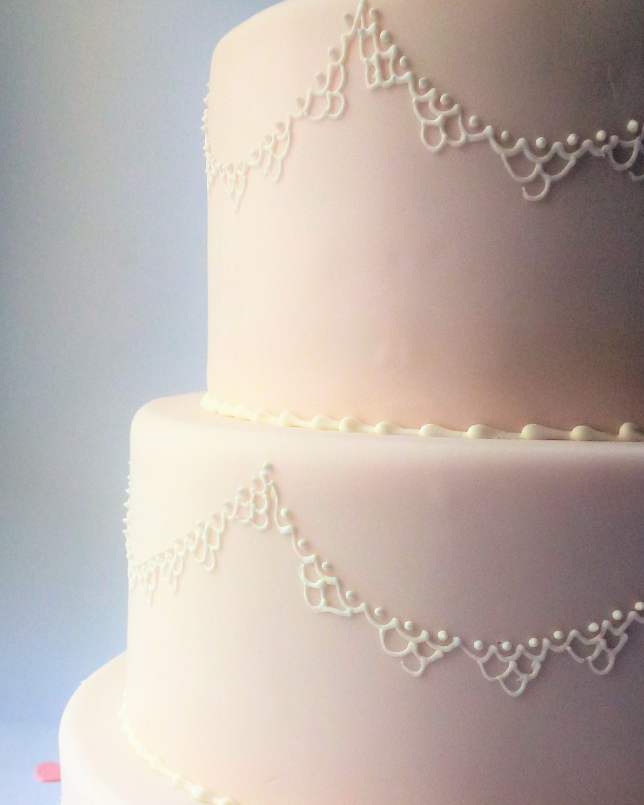 Baby pink coated wedding cake
