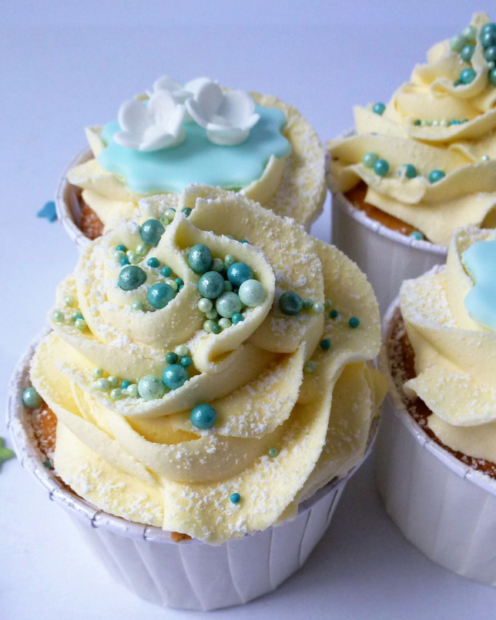 cupcake with a swirl of buttercream and sprinkles