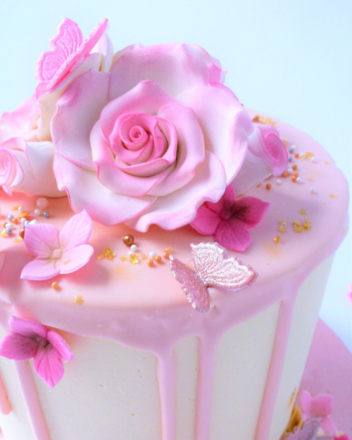 Sugar flowers and butterfly in pink
