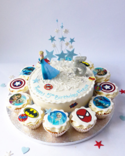 Cake with cupcakes and character toppers
