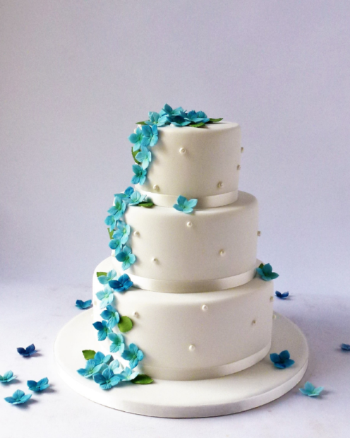 3 tier wedding cake with blue