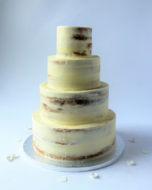 4 tier seminaked wedding cake mixed flavours