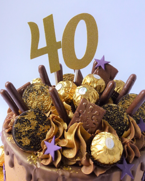 Number cake topper on a drip cake
