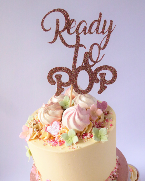 Tope tier baby shower cake