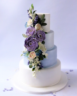 4 tier wedding cake with blue