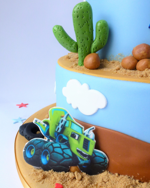erMonster truck on a birthday cake