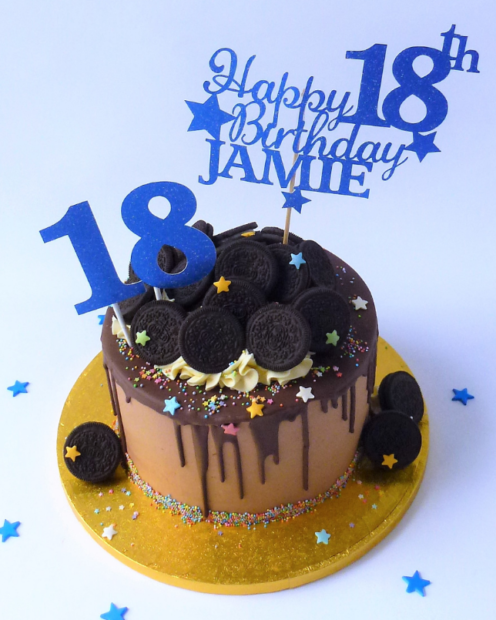 Chocolate birthday cake with topper
