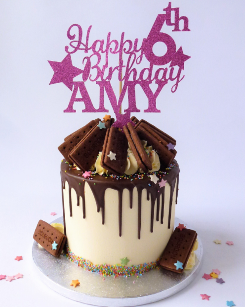 Birthday drip cake with topper