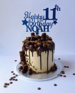 cake with chocolates and chocolate drip
