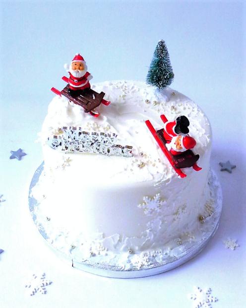 Christmas cake with Santa sledging