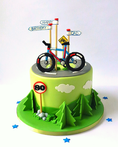 Birthday cake with a bike and trees