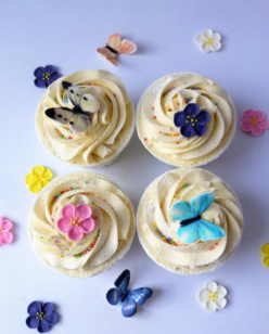 Cupcakes with a flower and butterfly topper