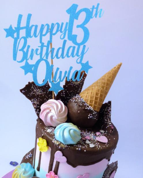 Blue cake topper on a ice cream cone birthday cake