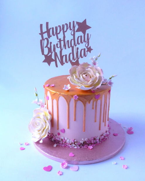 Rose gold and pale pink drip cake