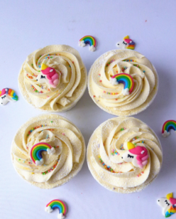 Cup cakes with unicorn & rainbow topper