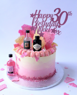 Birthday cake with miniature Gin Bottles