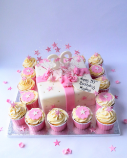 Birthday cake with cupcakes pink