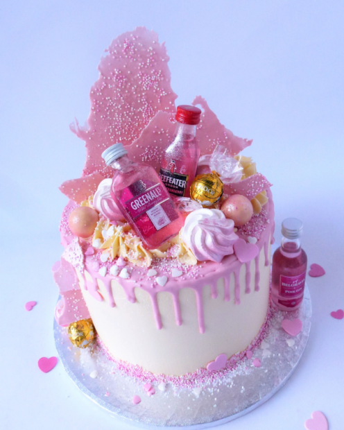 Pink gin on a birthday cake