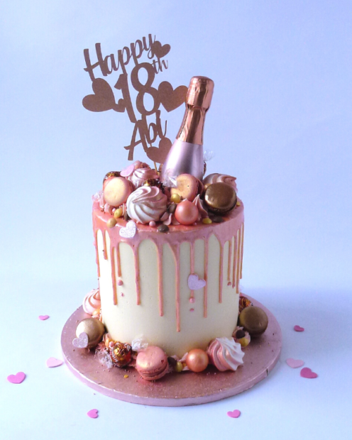 Drip cake with champagne bottle