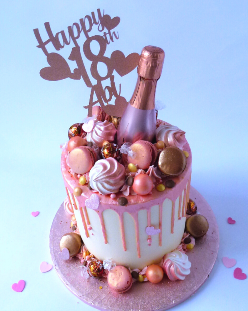 Rose gold birthday cake with macaroons