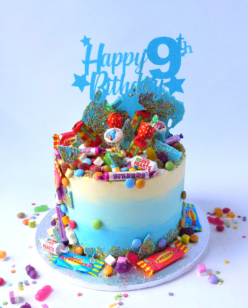 Birthday cake covered in sweets