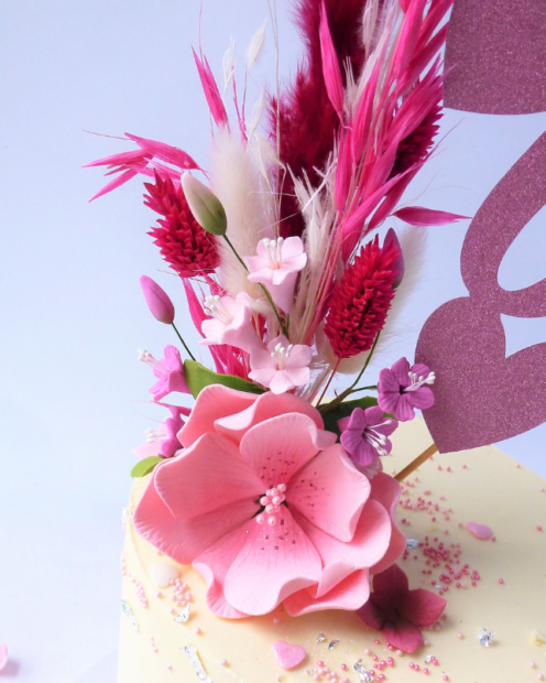 Sugar and dried flower cake topper