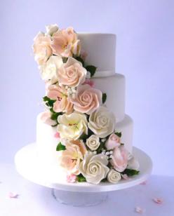Pastel pink flowers on wedding cake