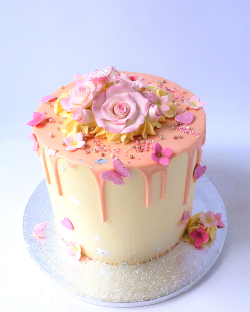 Pink and silver drip cake