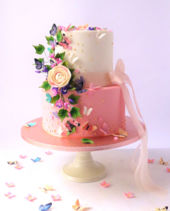 2 tier birthday cake in coral and pink